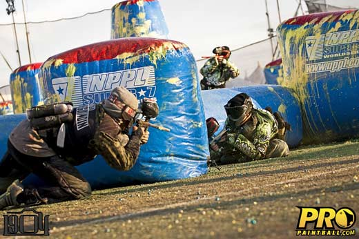 Professional paintball players battling it out